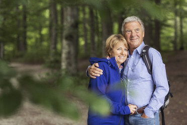 Portrait of couple standing in forest - CUF31635