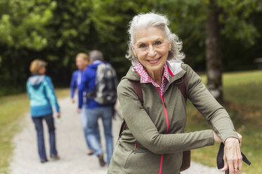 Portrait of senior woman on pathway in forest - CUF31641