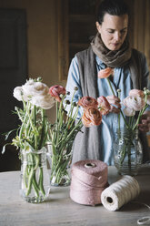 Woman arranging fresh flowers - ALBF00460