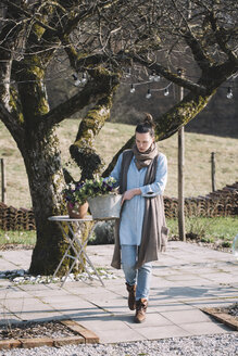 Woman carrying basket with fresh flowers - ALBF00475