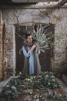 Woman arranging twigs - ALBF00481