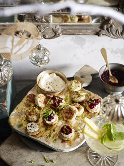 Sage and mustard chicken patties with micro herbs and cranberry relish - CUF32198