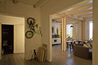 View of storage room, kitchen, dining area, couch and bicycle on wall - CUF32291