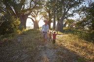 Mother and sons enjoying view, Nxai Pan National Park, Kalahari Desert, Africa - ISF09952