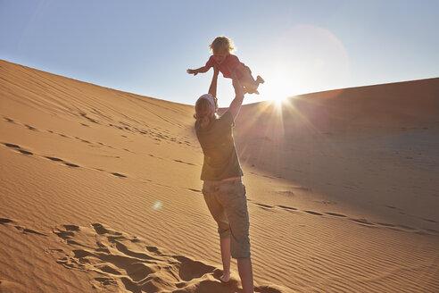 Mother playing with son on sand dune, Namib Naukluft National Park, Namib Desert, Sossusvlei, Dead Vlei, Africa - ISF09970