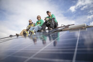 Construction crew taking  break from installing solar panels on a house - ISF10231