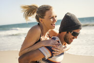Couple on vacation at beach, Malibu, California, USA - ISF10246