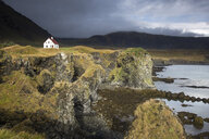 Remote house on craggy, remote cliff, Arnarstapi, Snaefellsnes, Iceland - CAIF20743