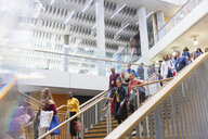 Business people descending office stairs - CAIF20914