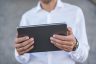 Close-up of businessman holding tablet - DIGF04707