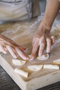 Woman preparing ravioli on pastry board - ALBF00505