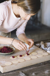 Woman preparing ravioli, beetroot sage filling - ALBF00511