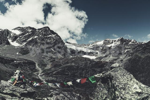 Italy, Lombardy, Lanzada, prayer flag in front of Fellaria glacier and Piz Palue and Piz Varuna - DWIF00926