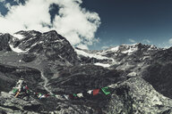 Italy, Lombardy, Lanzada, prayer flag in front of Fellaria glacier and Piz Palue and Piz Varuna - DWIF00926