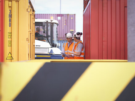 Port workers with shipping containers in port - CUF32838