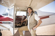 Pilot standing beside plane, Wellington, Western Cape, South Africa - ISF10439