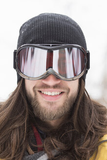 Close up portrait of smiling male snowboarder on street - ISF10791