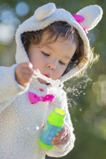 Little girl blowing bubbles - ISF10806