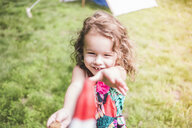 Girl in garden reaching for ice lolly - ISF10863