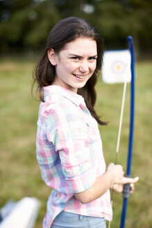 Portrait of teenage girl practicing archery - ISF10875