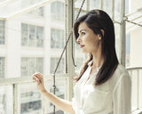 Businesswoman looking out of office window - ISF11031