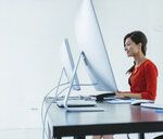 Businesswoman working at desk - ISF11052