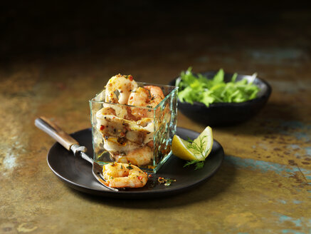 Still life of dressed king prawn and chargrilled calamari with bowl of mixed salad - ISF11064