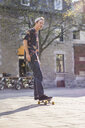 Young man skateboarding on street, Le Plateau, Montreal, Quebec, Canada - ISF12309