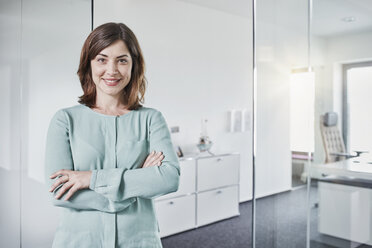 Portrait of smiling businesswoman in office - RORF01357
