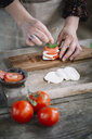 Woman's hands preparing Caprese Salad - ALBF00523