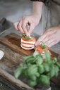 Woman's hands preparing Caprese Salad - ALBF00529