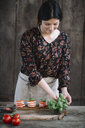 Woman preparing Caprese Salad - ALBF00532