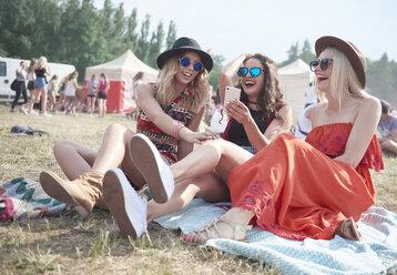 Happy friends making selfie at music festival - ABIF00593