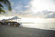 Thailand, Khao Lak, rows of laid tables, chairs and beach umbrellas at seaside - CHPF00477