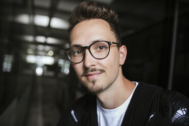 Portrait of young man wearing glasses - KMKF00378