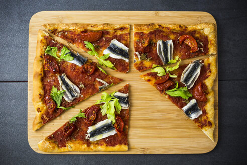 Pizza Marinara garnished with anchovies and parsley - GIOF03979