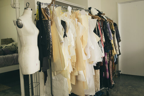 Tailors dummy and clothes rail in fashion studio - ISF12956