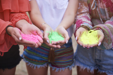 Holi colors in hands of women - ABIF00613