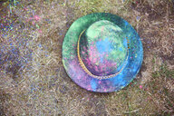 Hat with colour powder on the grass - ABIF00619