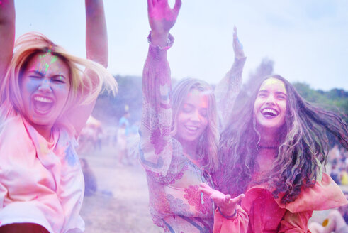Crazy friends having fun with holi powder - ABIF00628