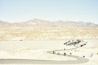 View of parking lot and tourists on winding desert road, Death Valley, California, USA - ISF13025