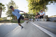 Young man skateboarding in park, Eastvale, California, USA - ISF13276