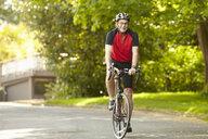 Senior man on bicycle - ISF13366
