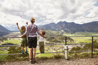 Mother and sons looking at mountain view, rear view, Garmisch-Partenkirchen, Bavaria, Germany - ISF13672