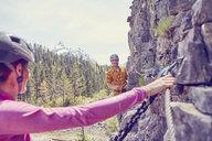 Couple rock climbing, Ehrwald, Tyrol, Austria - ISF13735