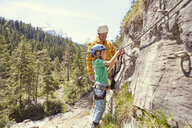 Father and child rock climbing, Ehrwald, Tyrol, Austria - ISF13768