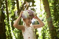 Portrait of pretty girl wearing flower headdress in forest - ISF13798