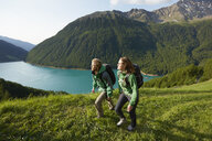 Young couple hiking at Vernagt reservoir, Val Senales, South Tyrol, Italy - ISF13924