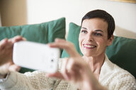 Woman taking selfie at home - ISF14065