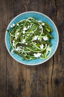Bowl of green asparagus salad with helically coiled cucumber and feta cheese - LVF07121